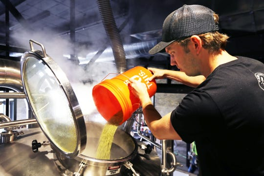 Brewer and co-founder Andy Jones makes beer at Good City Brewing.
