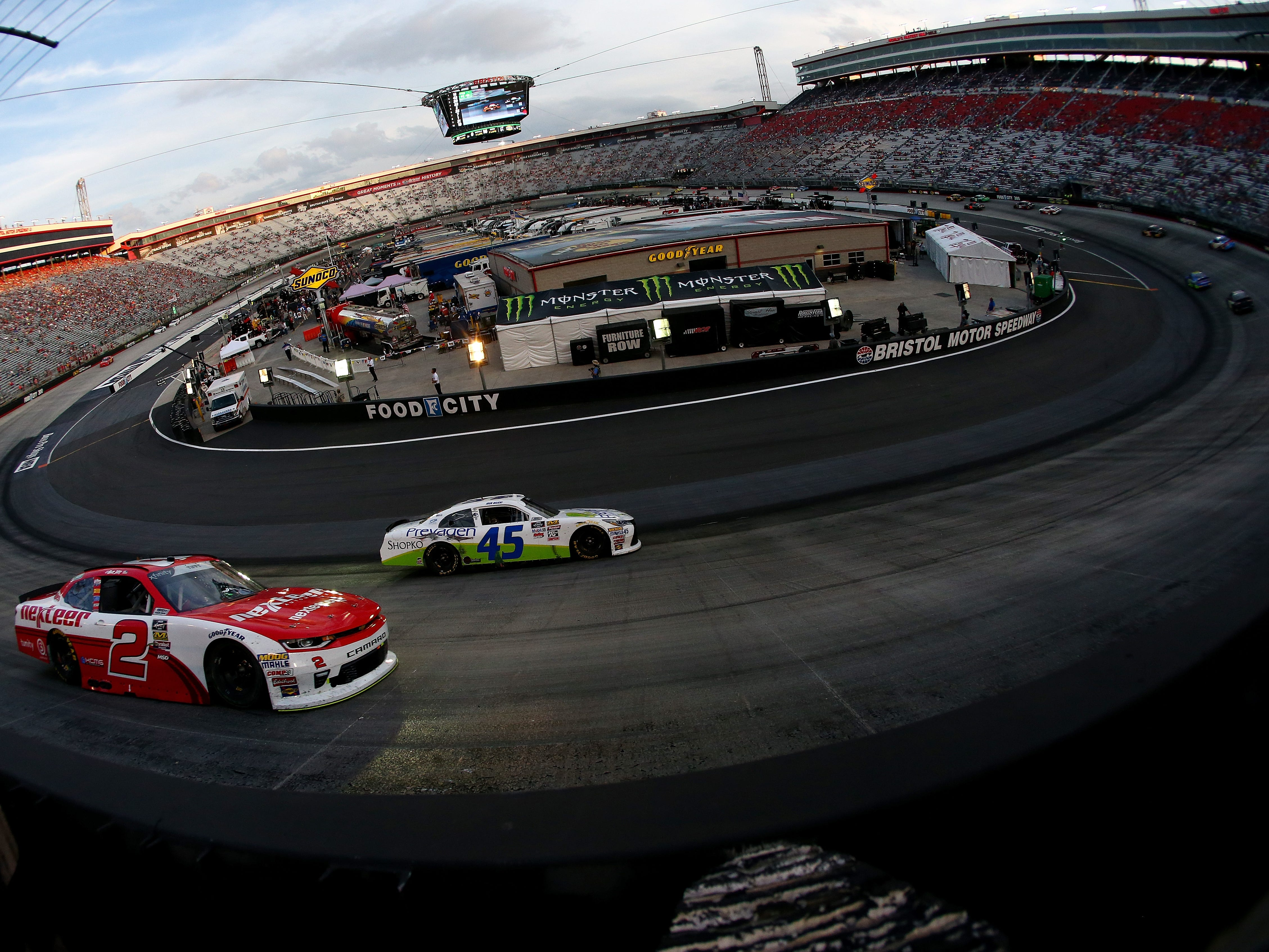BRISTOL, TN - AUGUST 17: Matt Tifft, driver of the #2 Nexteer Chevrolet, and Josh Bilicki, driver of the #45 Prevagen Toyota, race during the NASCAR Xfinity Series Food City 300 at Bristol Motor Speedway on August 17, 2018 in Bristol, Tennessee.  (Photo by Sarah Crabill/Getty Images)