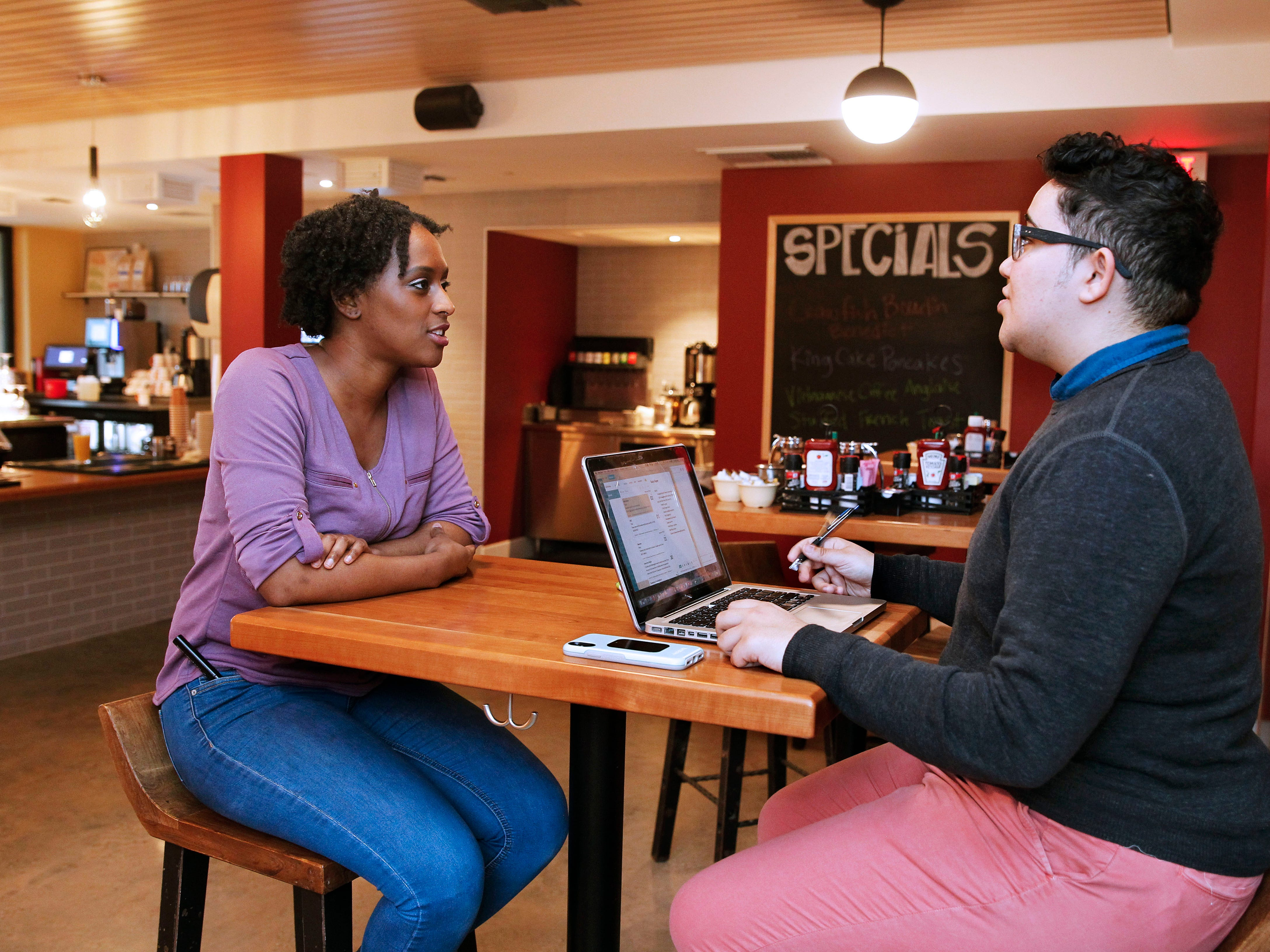Talaris Randolph (left) assistant manager at the Red Slipper, meets with Ileana Ortiz, an education adviser at EdNavigator.