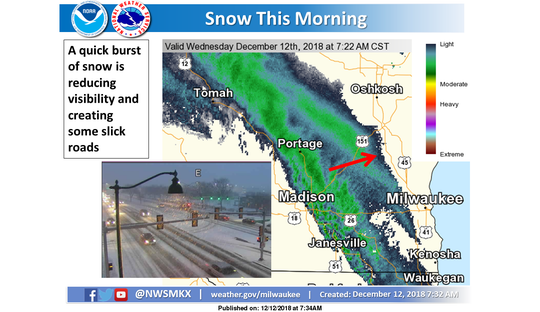 The first band of snow Wednesday was moving east toward Milwaukee.