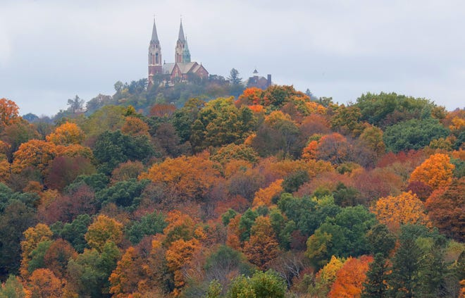 A canopy of fall-colored trees surround the Basilica and National Shrine of Mary Help of Christians at Holy Hill as the fall colors start to pop in Hubertus on  Oct. 6, 2018.
