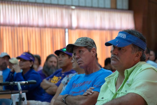 Louisiana shrimpers listen to speakers Aug. 8 at the Louisiana Shrimp Association meeting in Houma, La. More than 100 people attended the meeting, at which the low price of shrimp was the primary topic.