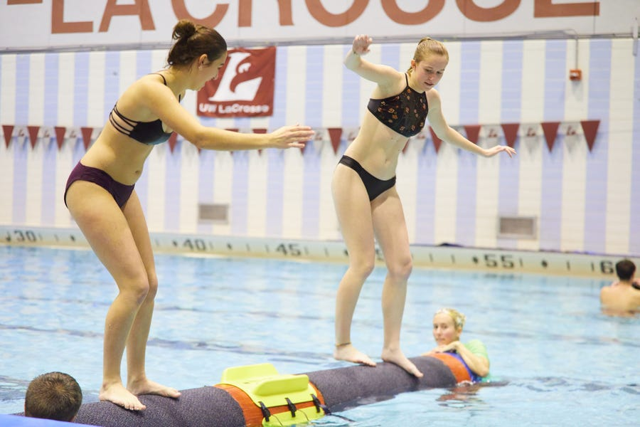 Gabriella Zaemisch (right), a freshman from Stoughton, competes against another student at UW-La Crosse, which offered logrolling as an activity during finals.