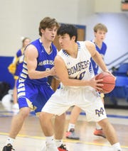 Mountain Home's Luke Kruse is guarded by Harrison's Gabe Huskey on Tuesday night at The Hangar.