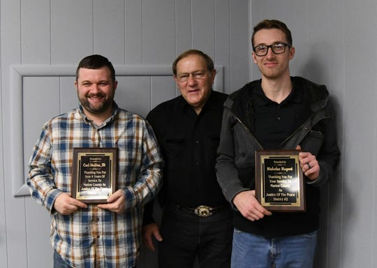 County Judge Terry Ott (center) presented plaques Tuesday night to justices of the peace that will be leaving the Quorum Court at the end of the year. Receiving plaques were Carl McBee Jr. (left) and Nicholas Nugent (right). A third JP, Gregg Alexander, is also leaving office but did not attend Tuesday's meeting.