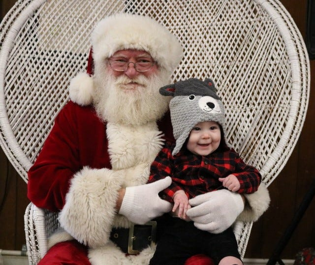 Nine-month-old Rogue Fox of Bull Shoals was happy to meet Santa during the Children's Christmas Party held earlier this month at the Bull Shoals VFW Hoevel-Barnett Post 1341.