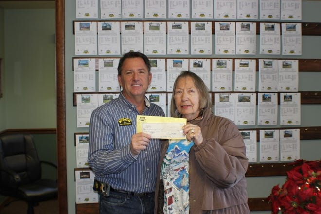 Gary Stubenfoll, Principal Broker/Owner of Beaman Realty, presents a check for $500 to Bull Shoals Theater of the Arts to help with expenses so they may continue the theater's success bringing live entertainment to the Bull Shoals/Lakeview area. Be sure to view their website for upcoming events: www.bullshoalstheater.net.