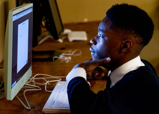 Kentavious Merriweather logs into a computer at That's My Child, a local youth organization, in Montgomery, Ala., on Wednesday December 12, 2018.