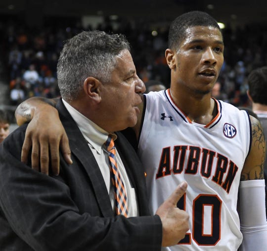 Auburn coach Bruce Pearl talks with guard Samir Doughty (10) at halftime against Washington at Auburn Arena on Nov. 9, 2018.