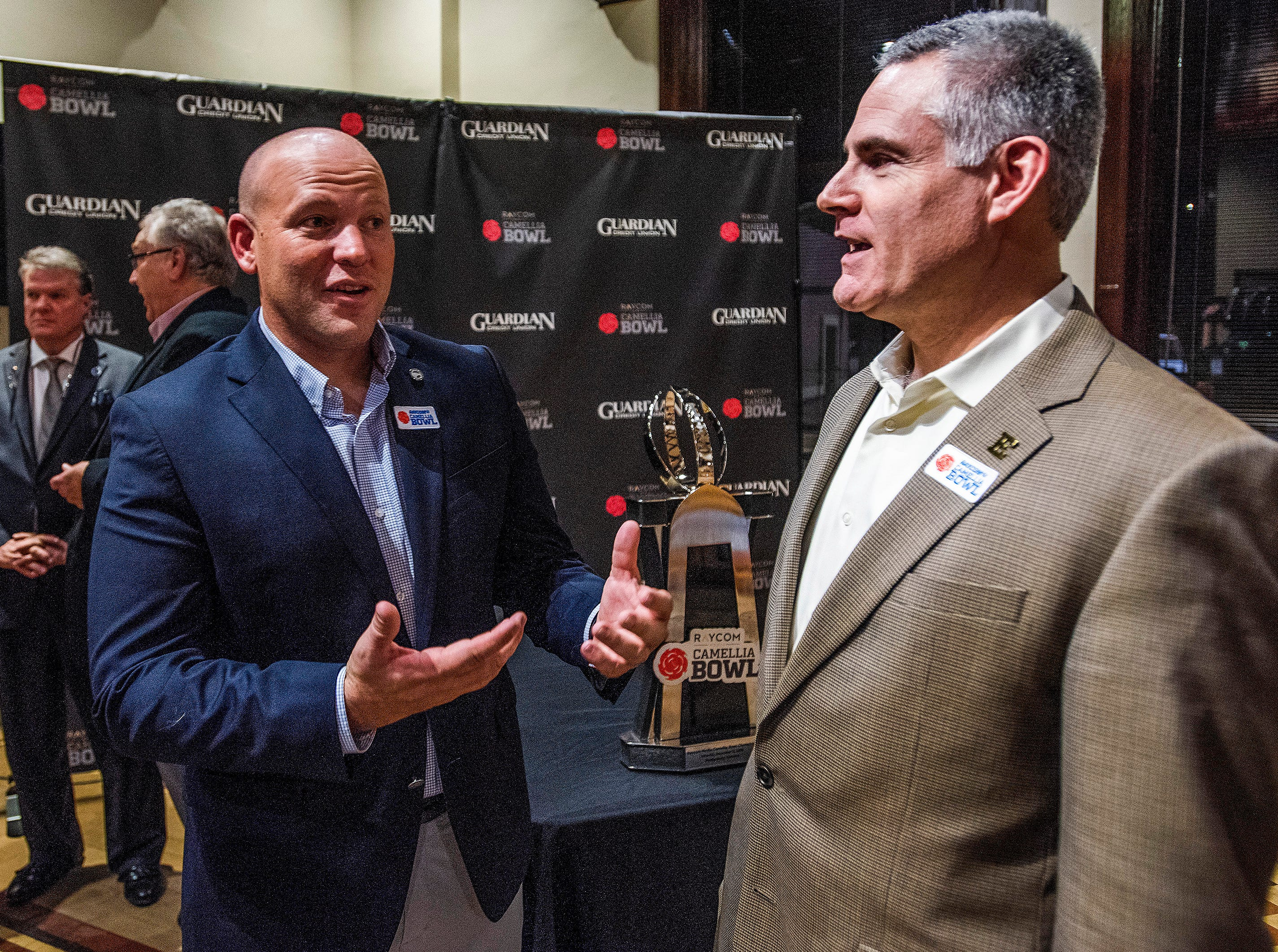 Georgia Southern head coach Chad Lunsford  and Eastern Michigan head coach Chris Creighton chat at the Camellia Bowl Coaches Press Conference in Montgomery, Ala., on Tuesday December 11, 2018.