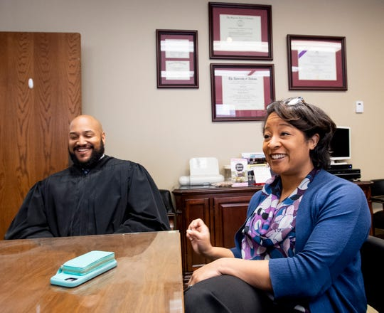 Circuit Judge J.R. Gaines and his wife, newly sworn in Montgomery District Judge Monet Gaines, chat at the Montgomery County Courthouse in Montgomery, Ala., on Wednesday December 12, 2018.