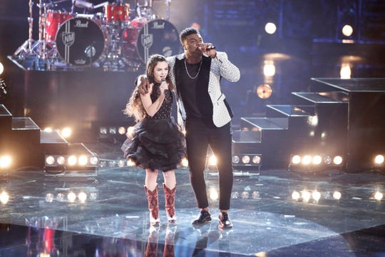 "Chevel Shepherd and Kirk Jay sing a country duet Monday, Dec. 10, 2018, in the semifinal round of NBC's ""The Voice."""