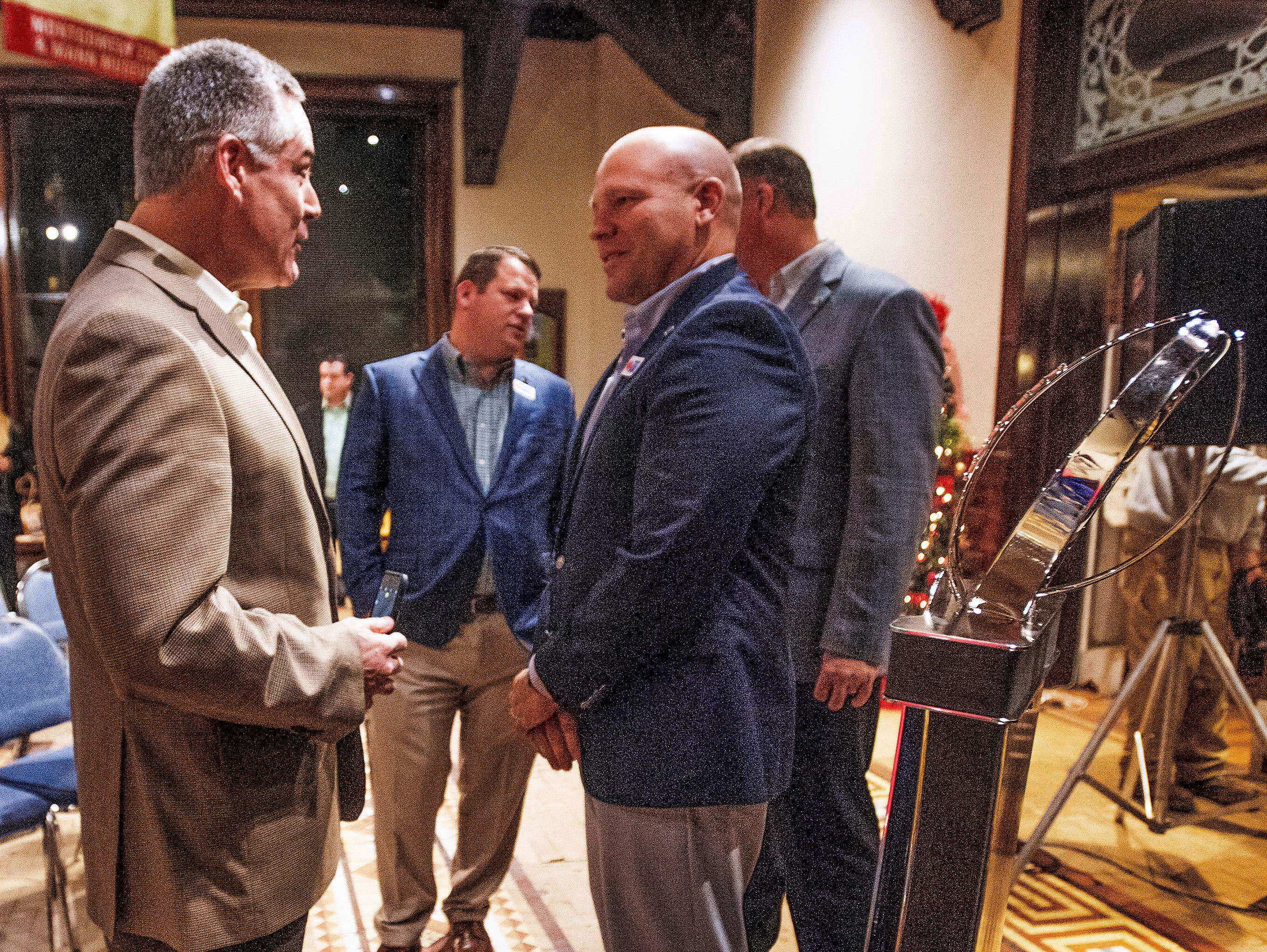 Eastern Michigan head coach Chris Creighton and Georgia Southern head coach Chad Lunsford chat at the Camellia Bowl Coaches Press Conference in Montgomery, Ala., on Tuesday December 11, 2018.