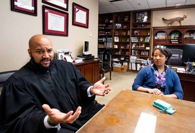 Circuit Judge J.R. Gaines and his wife, newly sworn in Montgomery District Judge Monet Gaines chat at the Montgomery County Courthouse in Montgomery, Ala., on Wednesday December 12, 2018.