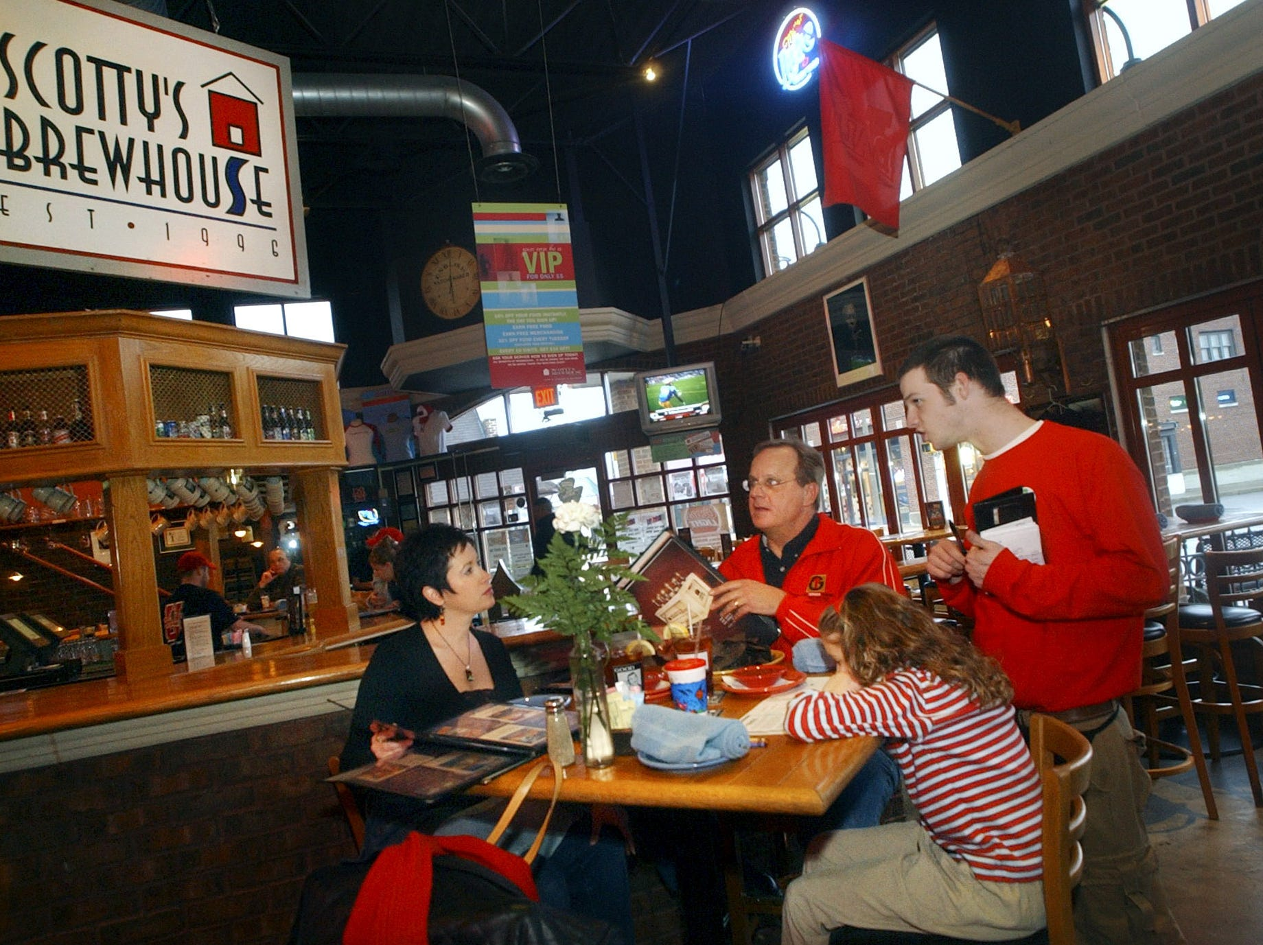 A family places dinner orders at Scotty's Brewhouse in The Village in this photo form 2006.