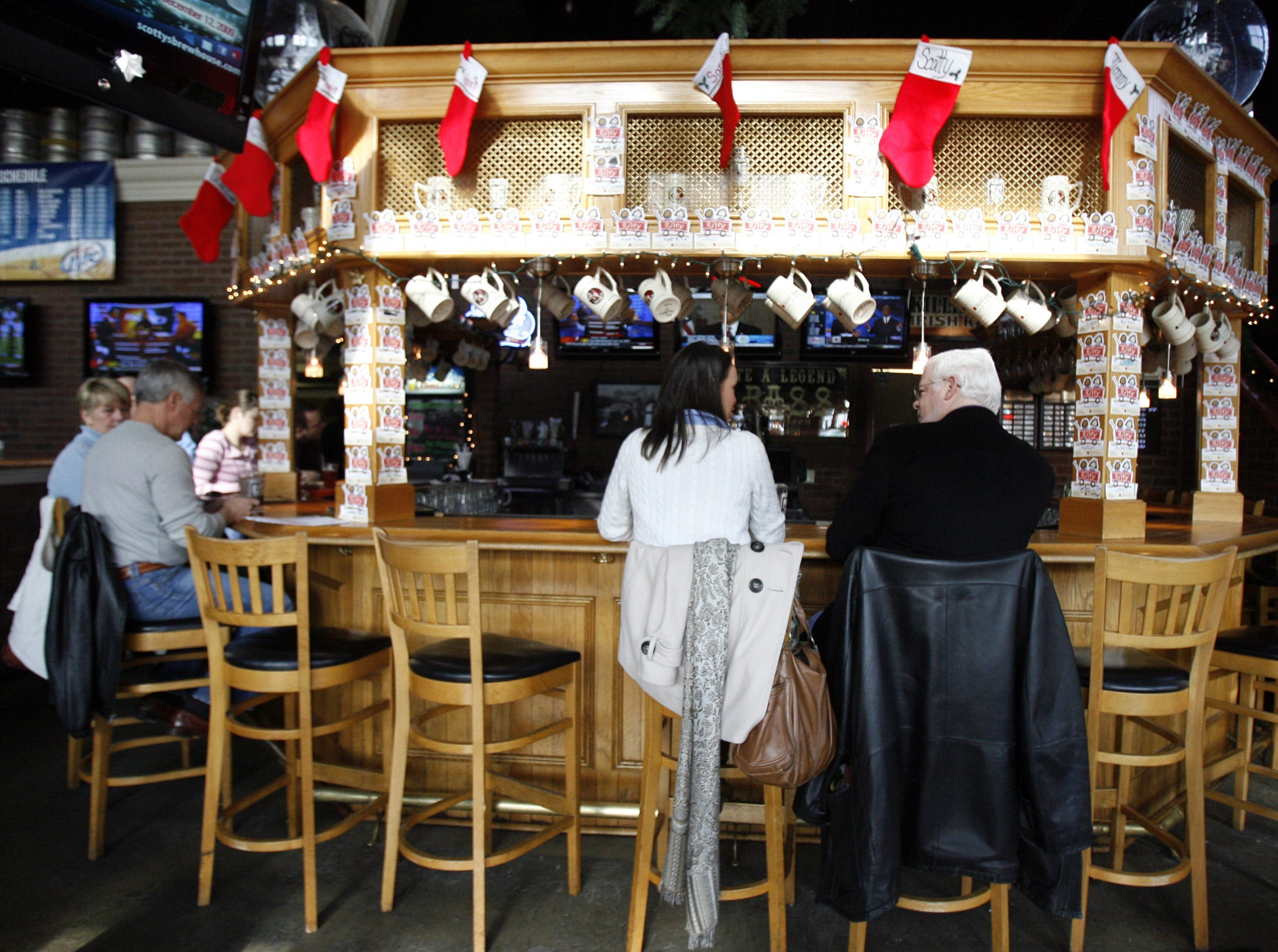 1214 People eat at the bar at Scotty's Brewhouse in Muncie in 2009.