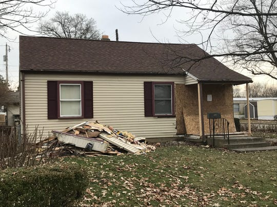 Authorities said a Muncie man was traveling about 80 mph Tuesday evening when his Jeep Cherokee slammed into a house at 18th and Beacon streets, injuring two people inside, two passengers in the vehicle and the driver.