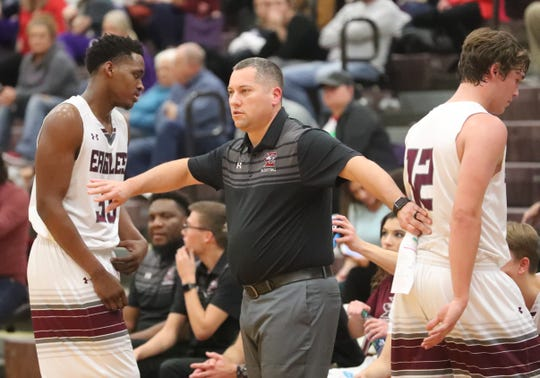 Eagleville's head coach Davy McClaran takes Eagleville's Mari Stoudemire (33) and Eagleville's Ethan Cobb (12) after a foul against Community during the game at Eagleville on Tuesday, Dec. 11, 2018.