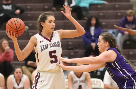 Eagleville's Lizzy Thompson (5) looks to pass the ball as Community's Payton Davis (35) guards her during the game at Eagleville on Tuesday, Dec. 11, 2018.