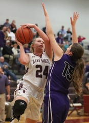 Eagleville's Anna Grace Clement (24) goes up for a basket as Community's AK Lemmons (15) guards her during the game at Eagleville on Tuesday, Dec. 11, 2018.