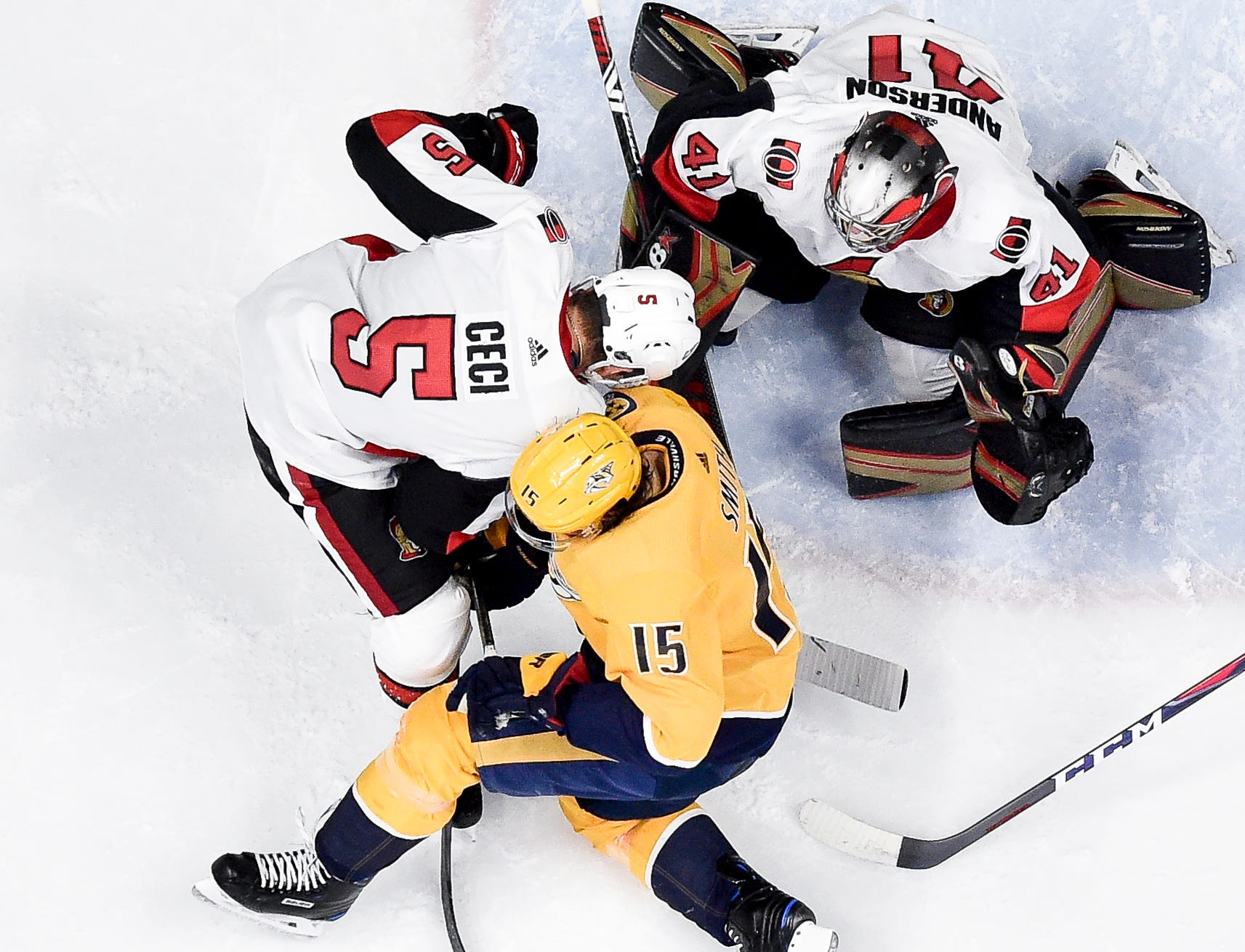 Nashville Predators right wing Craig Smith (15) flights for the puck with Ottawa Senators defenseman Cody Ceci (5) and goaltender Craig Anderson (41) during the second period at Bridgestone Arena in Nashville, Tenn., Tuesday, Dec. 11, 2018.