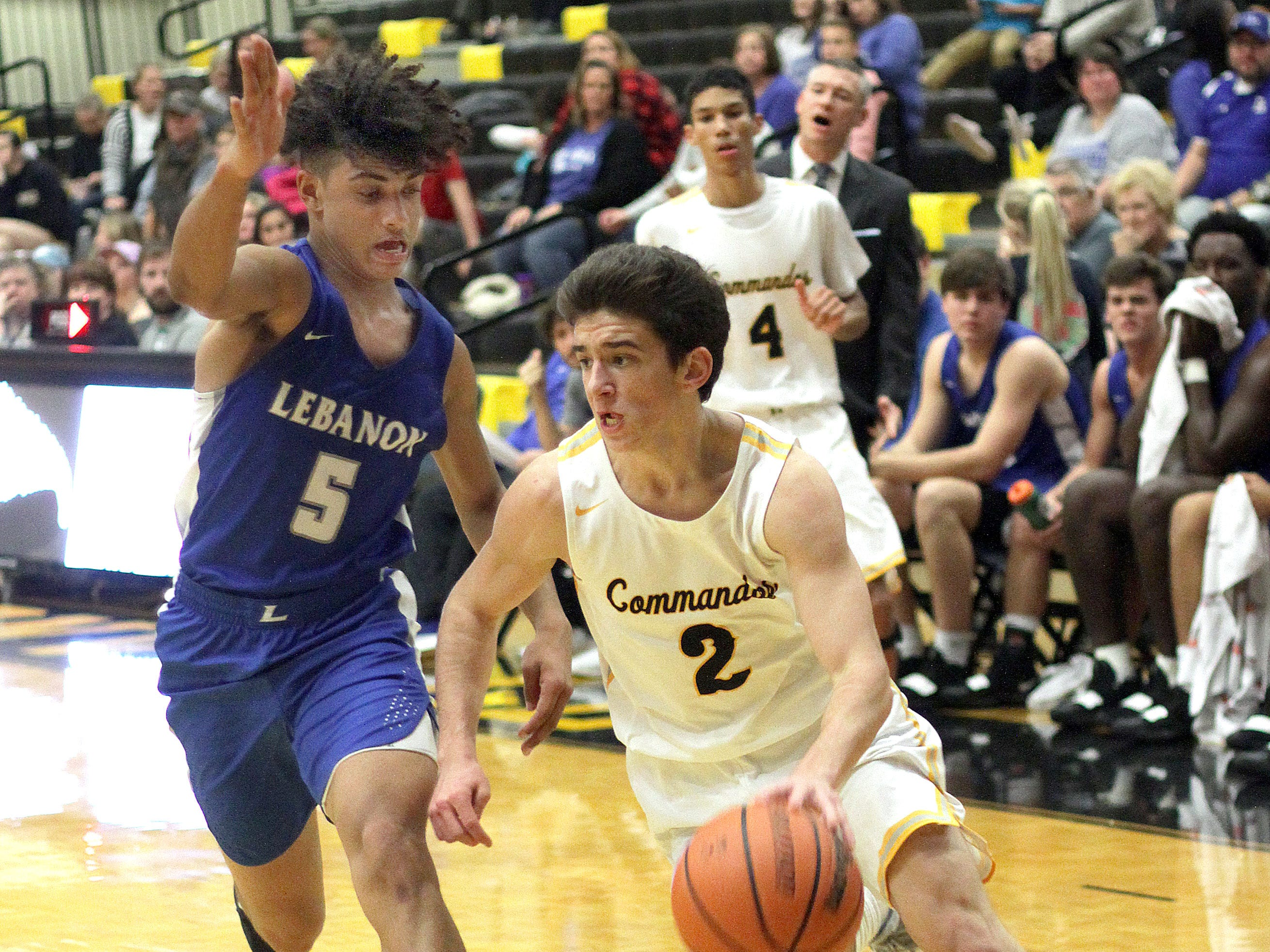 Hendersonville's Grant Long drives against Lebanon's Jeremiah Hastings on Tuesday, December 11, 2018.