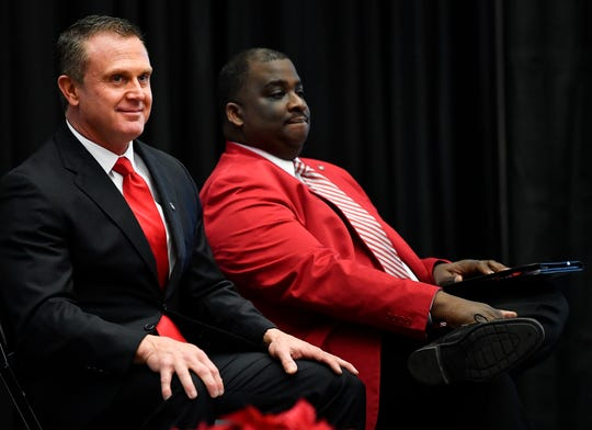 Austin Peay new head football coach Mark Hudspeth sits with athletic director Gerald Harrison as he waits to be introduced at the Dunn Center Wednesday, Dec. 12, 2018, in Clarksville, Tenn.