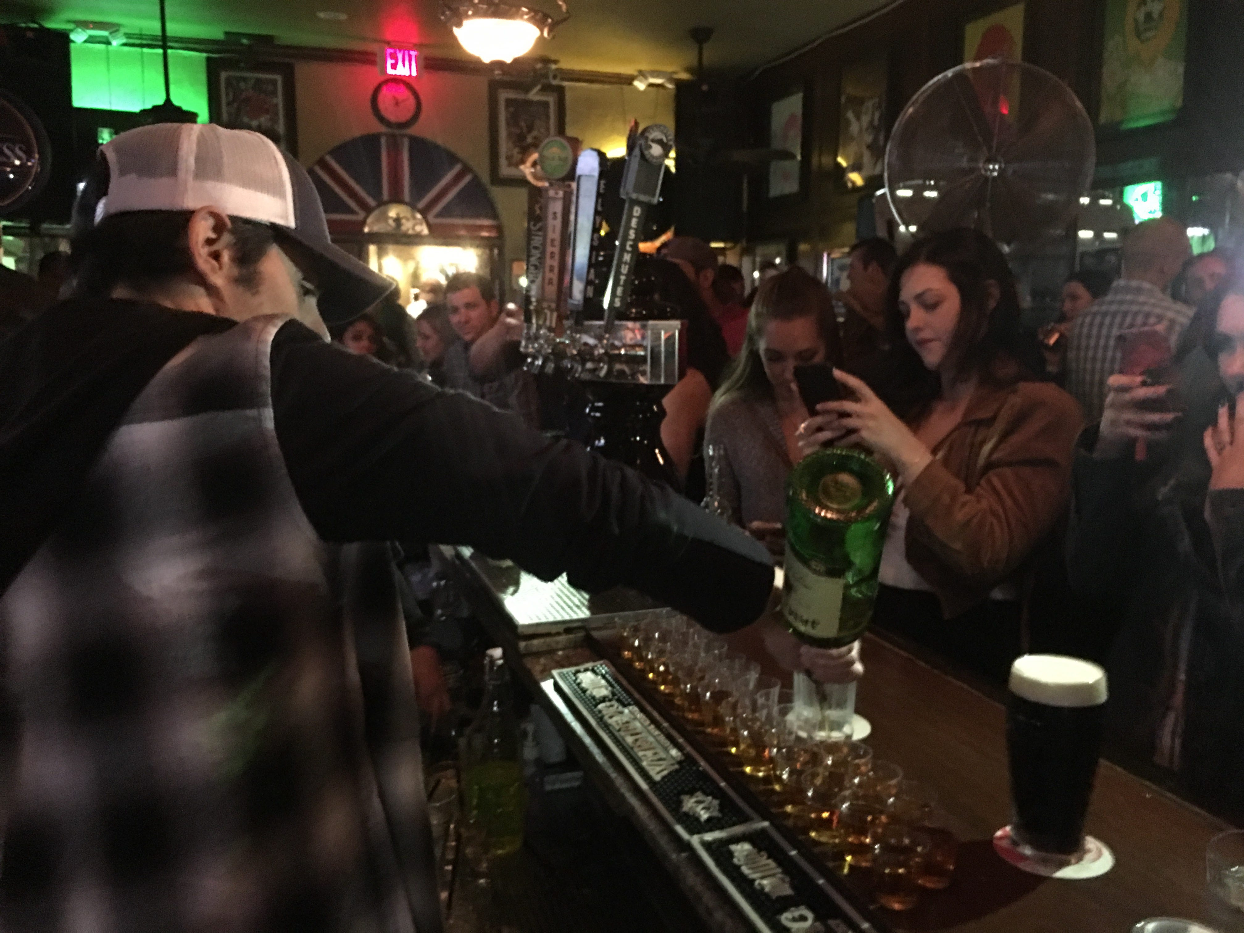 Brad Paisley pours shots at Old King's Road pub in Santa Barbara, Calif., May 12, 2018, before he plays a concert in the city to benefit victims of wildfires and mudslides. Paisley wanted to give a boost to businesses in Santa Barbara.