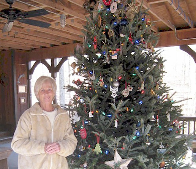 Janie Wells stands beside the Memory Tree in Bowie Nature Park.