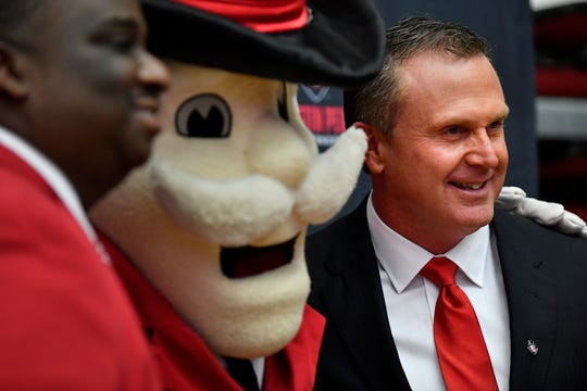 Austin Peay new football coach Mark Hudspeth (rt) poses for pictures with the APSU mascot and athletic director Gerald Harrison at the Dunn Center Wednesday, Dec. 12, 2018, in Clarksville, Tenn.