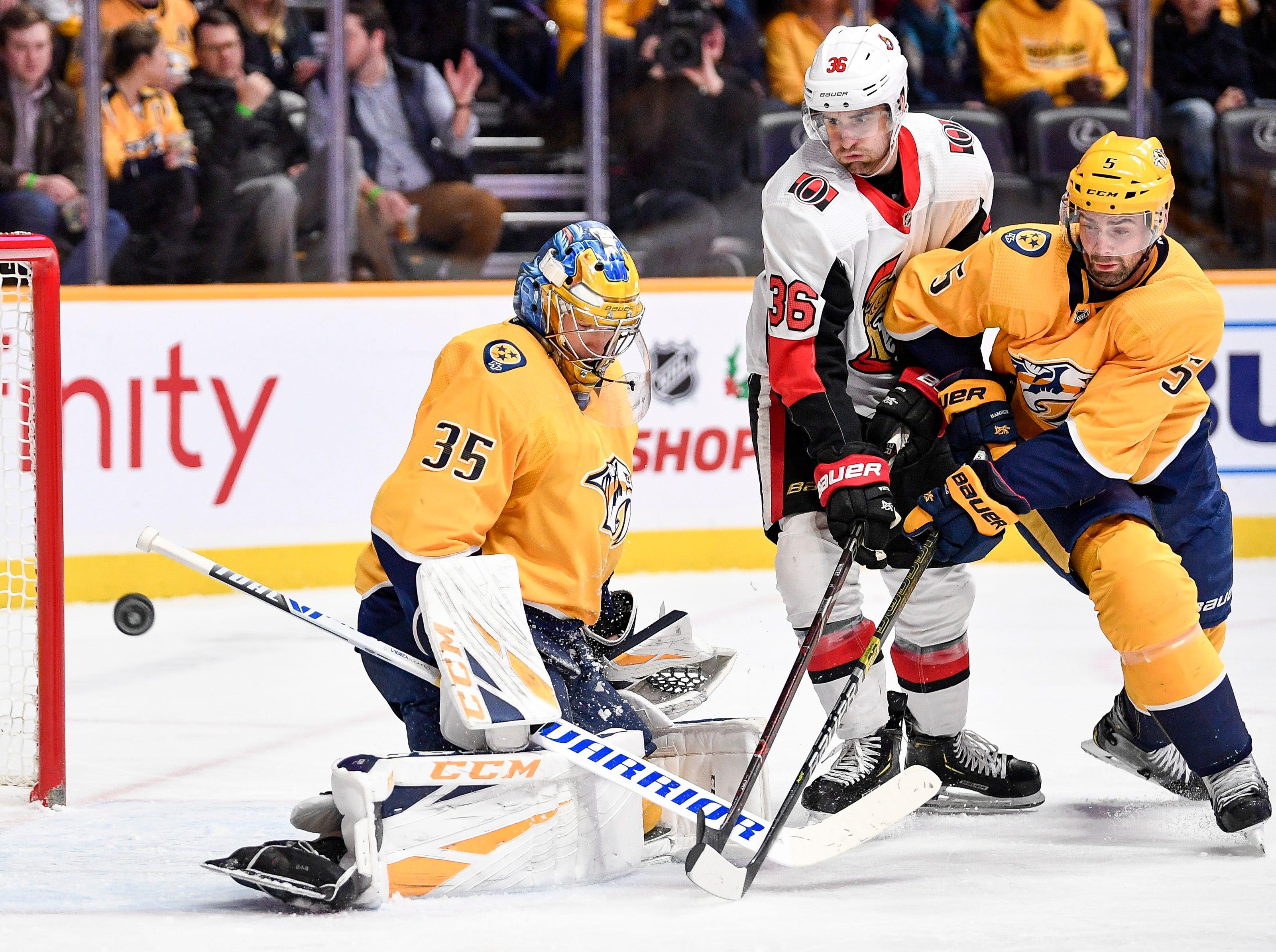 Nashville Predators goaltender Pekka Rinne (35) and defenseman Dan Hamhuis (5) defend against Ottawa Senators center Colin White (36) during the second period at Bridgestone Arena in Nashville, Tenn., Tuesday, Dec. 11, 2018.