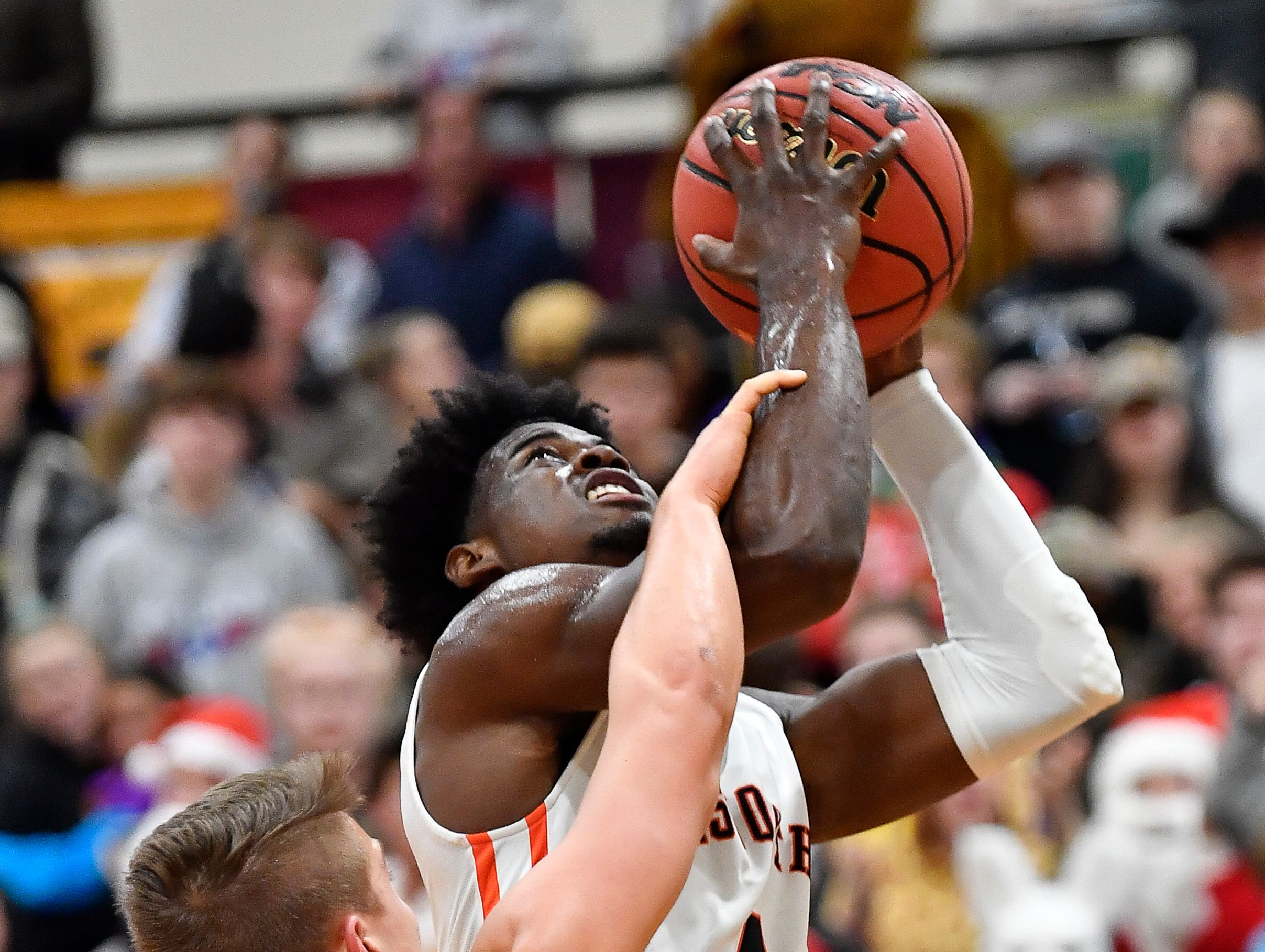 Ensworth forward Keshawn Lawrence (4) shoots CPA's McNeill Stout (5) during their game at Ensworth High School Tuesday, Dec. 11, 2018, in Nashville, Tenn.