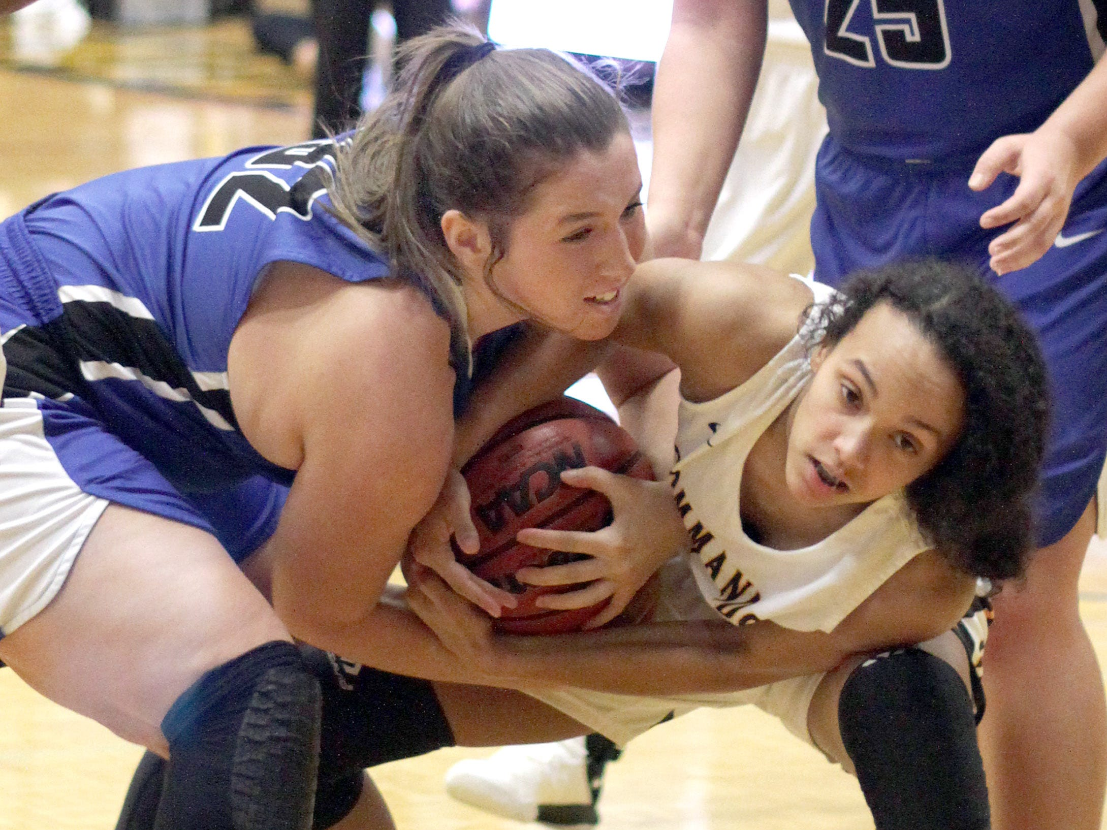 L-R Lebanon's Rebecca Brown wrestles for the ball with Hendersonville's Kayla Minchey on Tuesday, December 11, 2018.