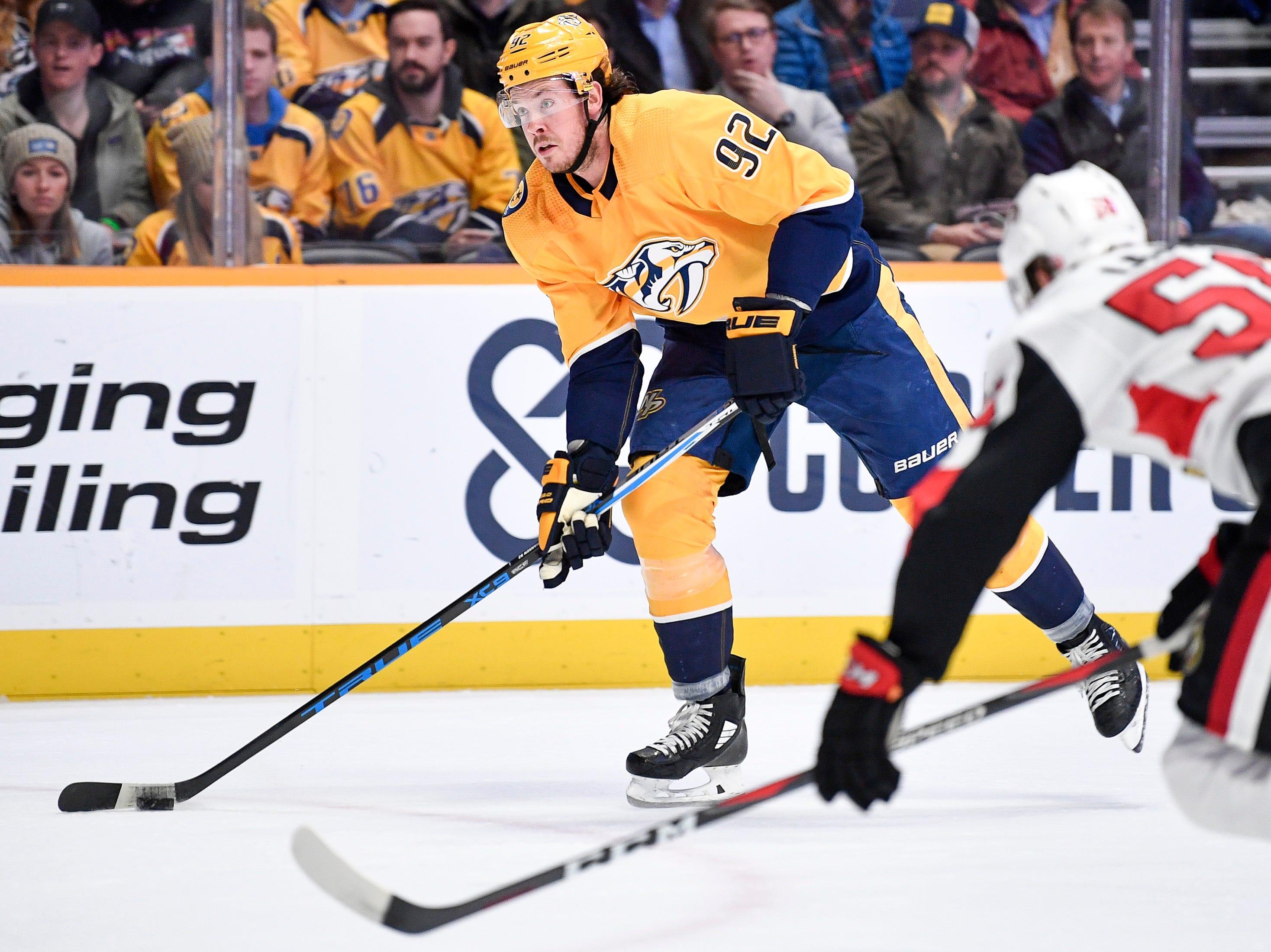 Nashville Predators center Ryan Johansen (92) advances into the path of Ottawa Senators defenseman Maxime Lajoie (58) during the first period at Bridgestone Arena in Nashville, Tenn., Tuesday, Dec. 11, 2018.
