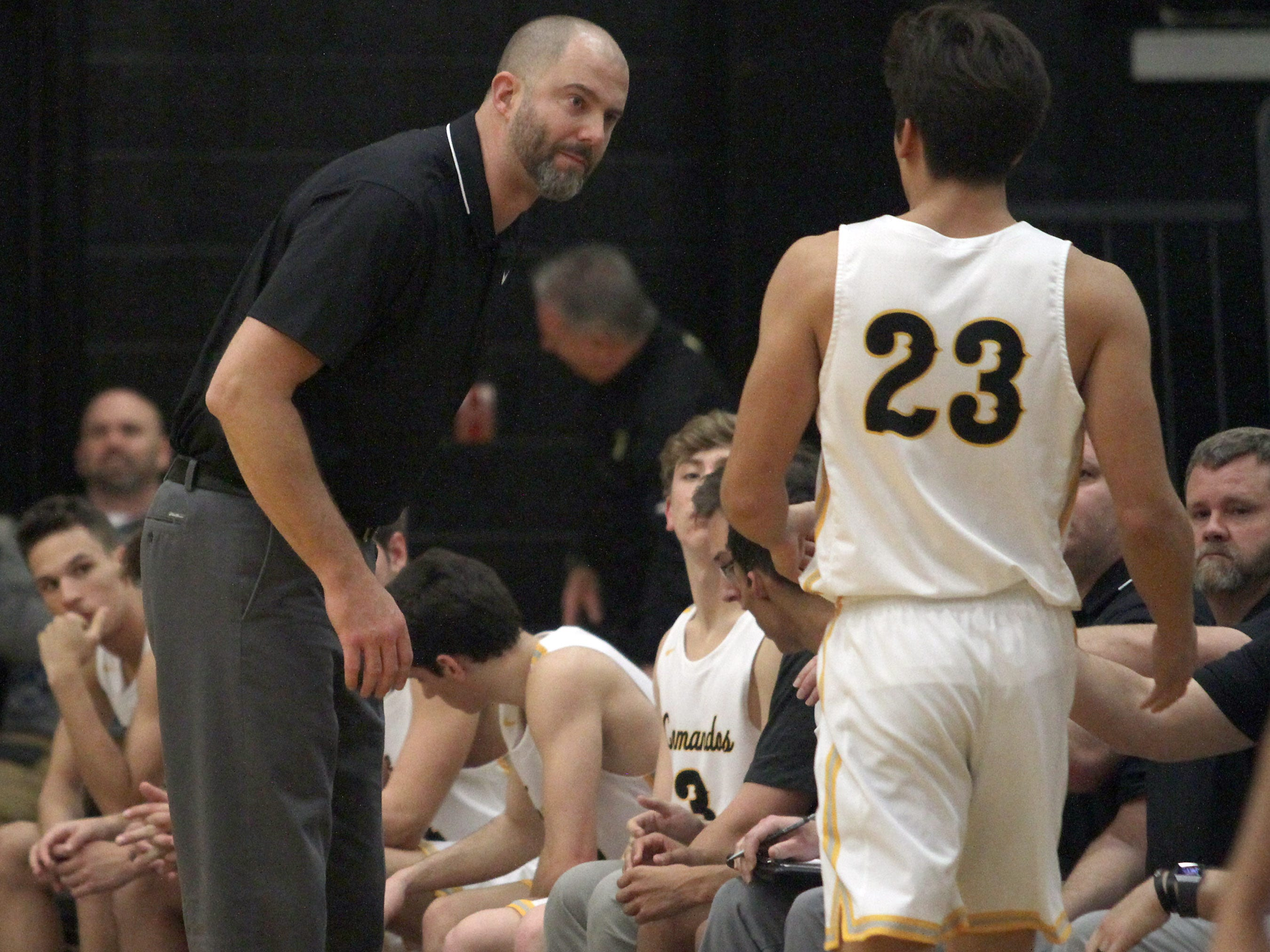 Hendersonville coach Clancy Hall looks to have a word with Derek Kincaid on Tueseday, December 11, 2018.