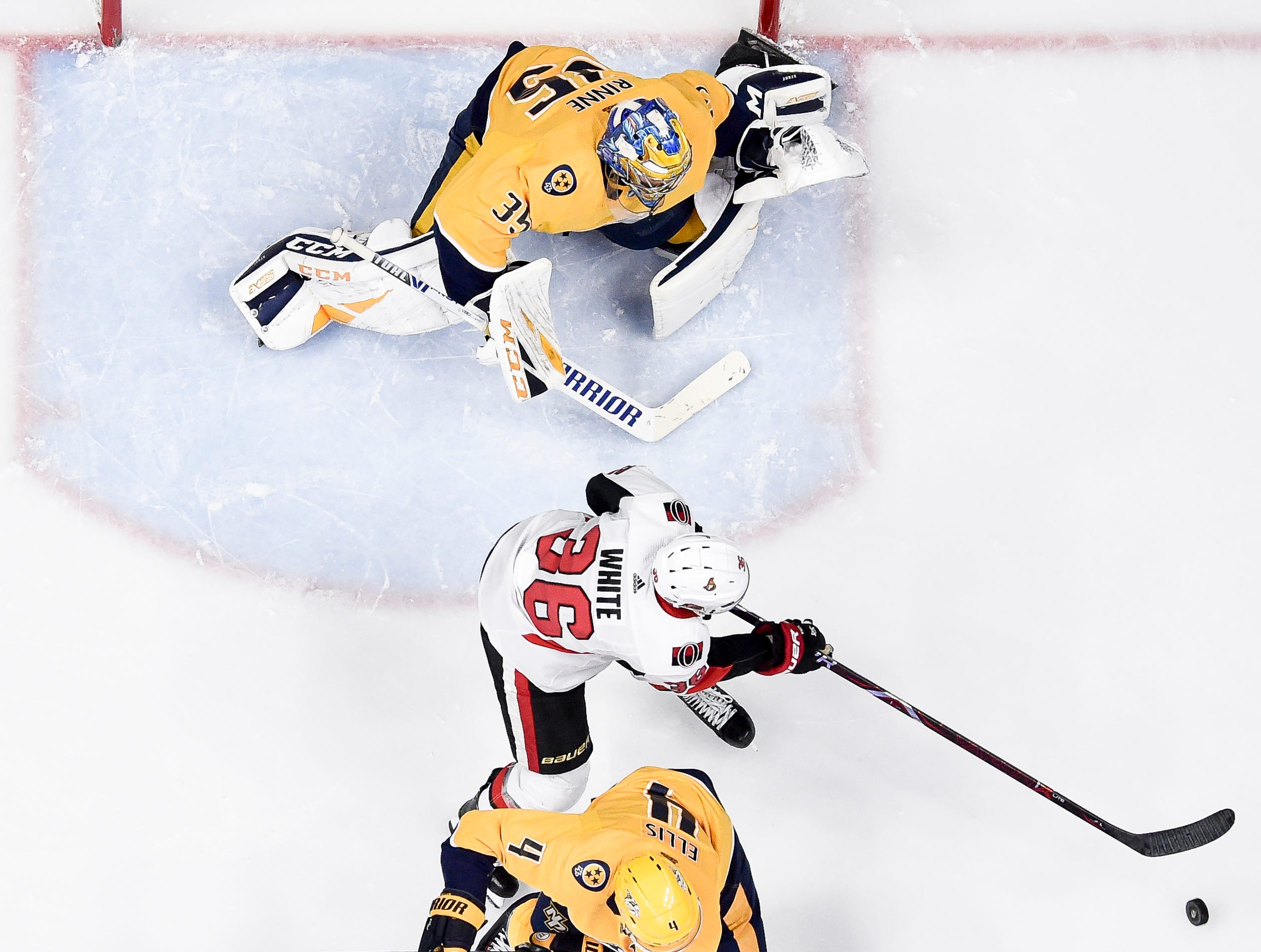 Ottawa Senators center Colin White (36) battles Nashville Predators goaltender Pekka Rinne (35) and defenseman Ryan Ellis (4) during the third period at Bridgestone Arena in Nashville, Tenn., Tuesday, Dec. 11, 2018.