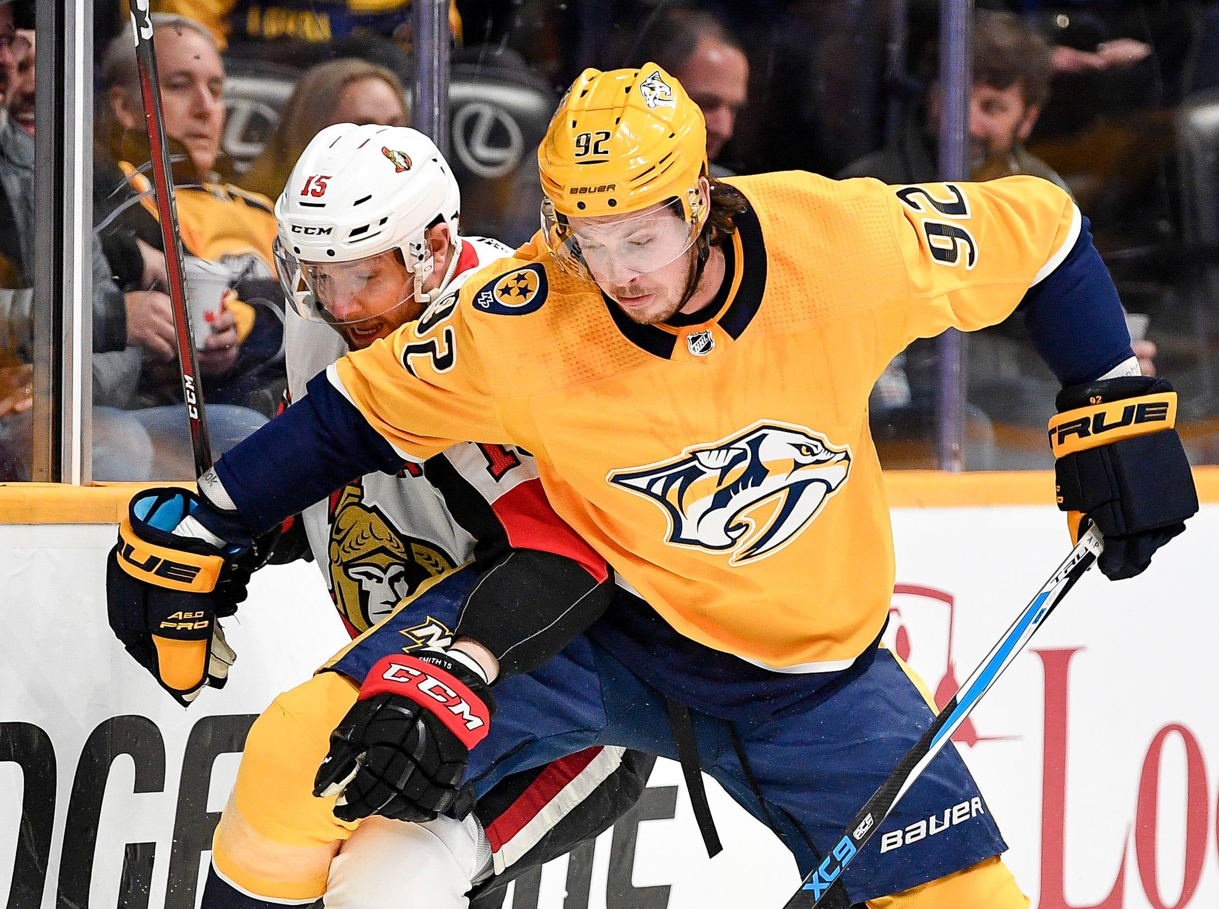 Nashville Predators center Ryan Johansen (92) collides into Ottawa Senators left wing Zack Smith (15) during the first period at Bridgestone Arena in Nashville, Tenn., Tuesday, Dec. 11, 2018.