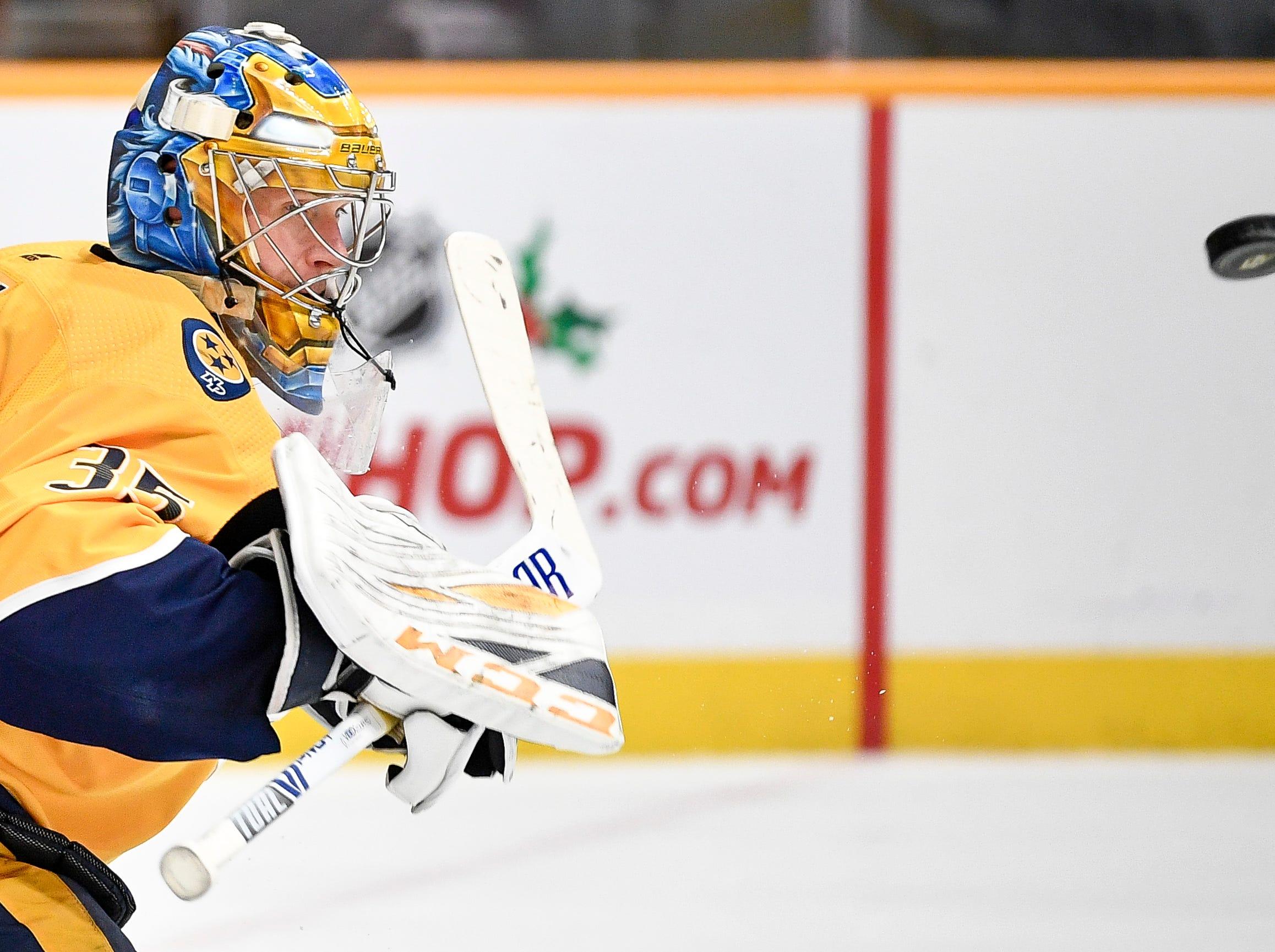 Nashville Predators goaltender Pekka Rinne (35) stops an Ottawa Senators shot during the second period at Bridgestone Arena in Nashville, Tenn., Tuesday, Dec. 11, 2018.