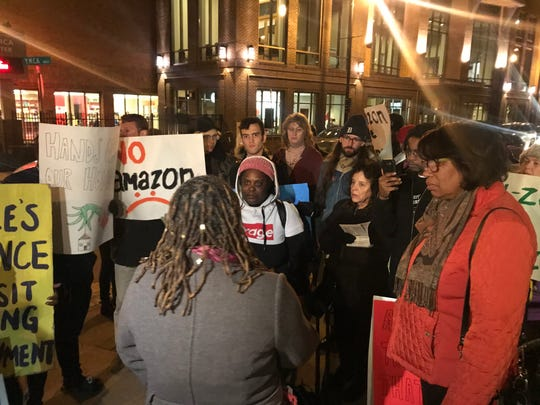 Pathe protesters meet on Church Street to seek demands for Amazon's new downtown hub.