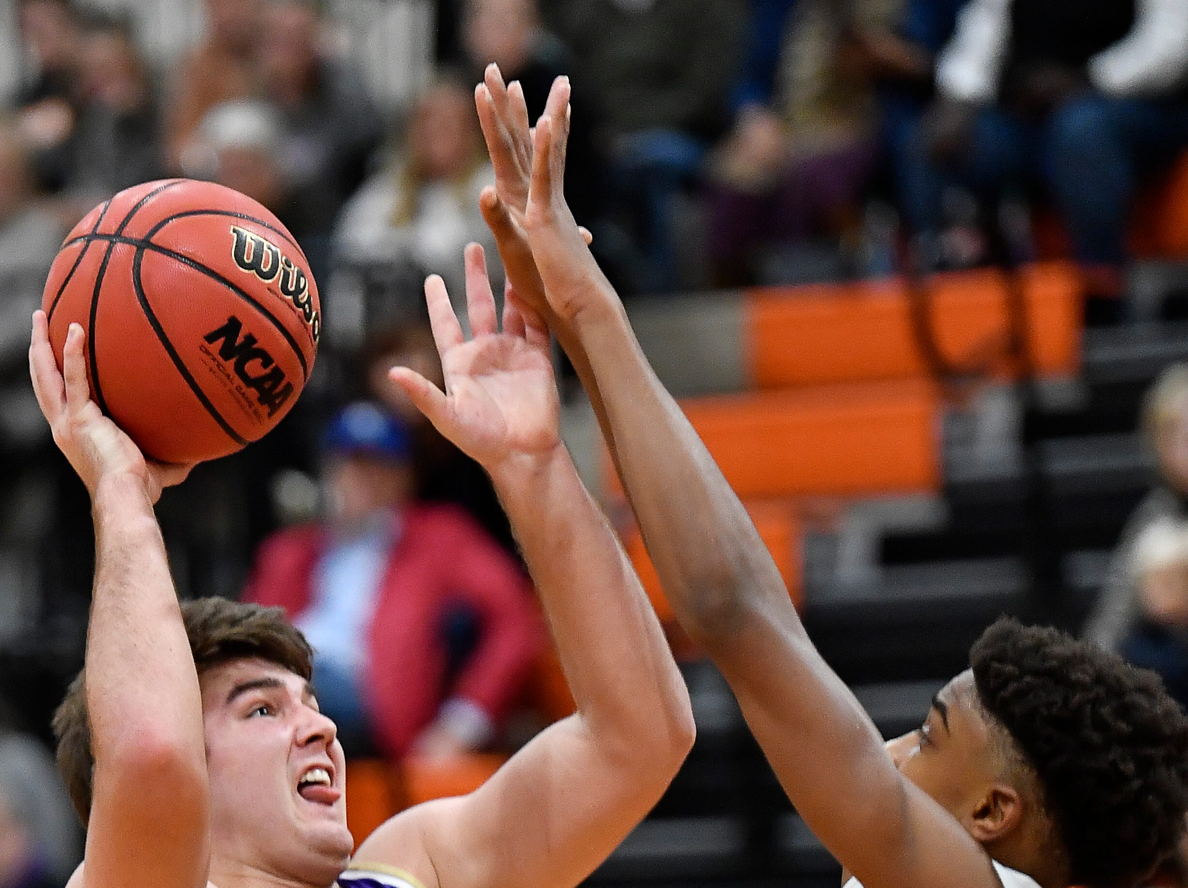 CPA's Mike McCormick (34) shoots over Ensworth guard Chaz Lanier (10) during their game at Ensworth High School Tuesday, Dec. 11, 2018, in Nashville, Tenn.