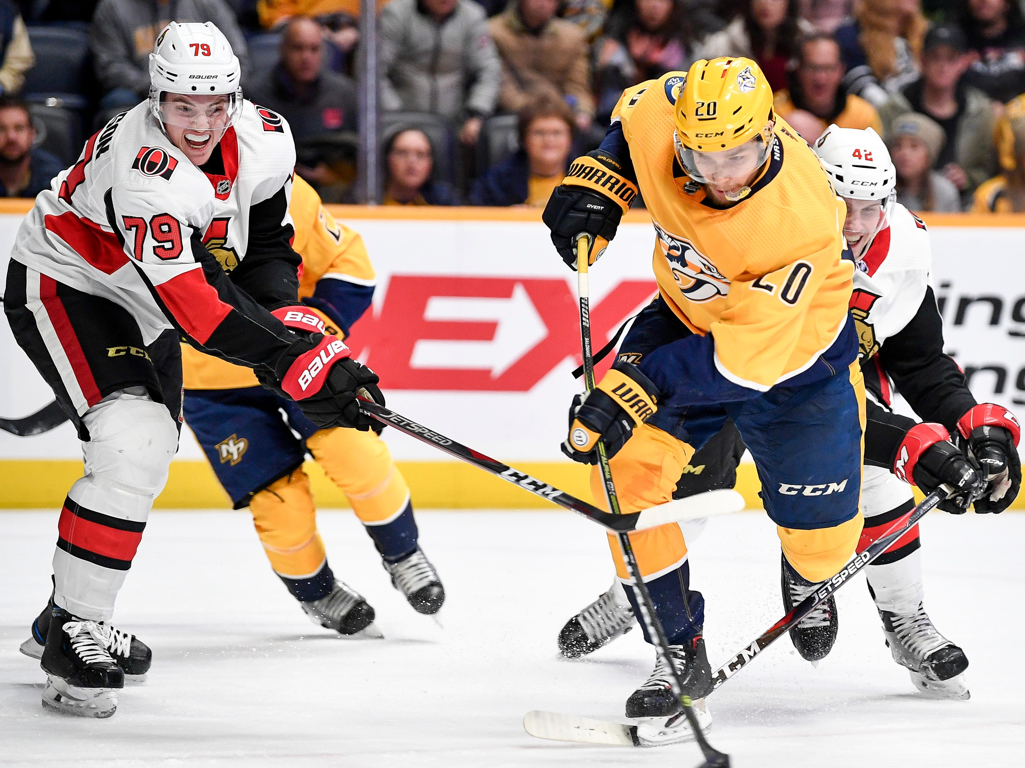 Nashville Predators right wing Miikka Salomaki (20) shoots past Ottawa Senators right wing Drake Batherson (79) during the first period at Bridgestone Arena in Nashville, Tenn., Tuesday, Dec. 11, 2018.