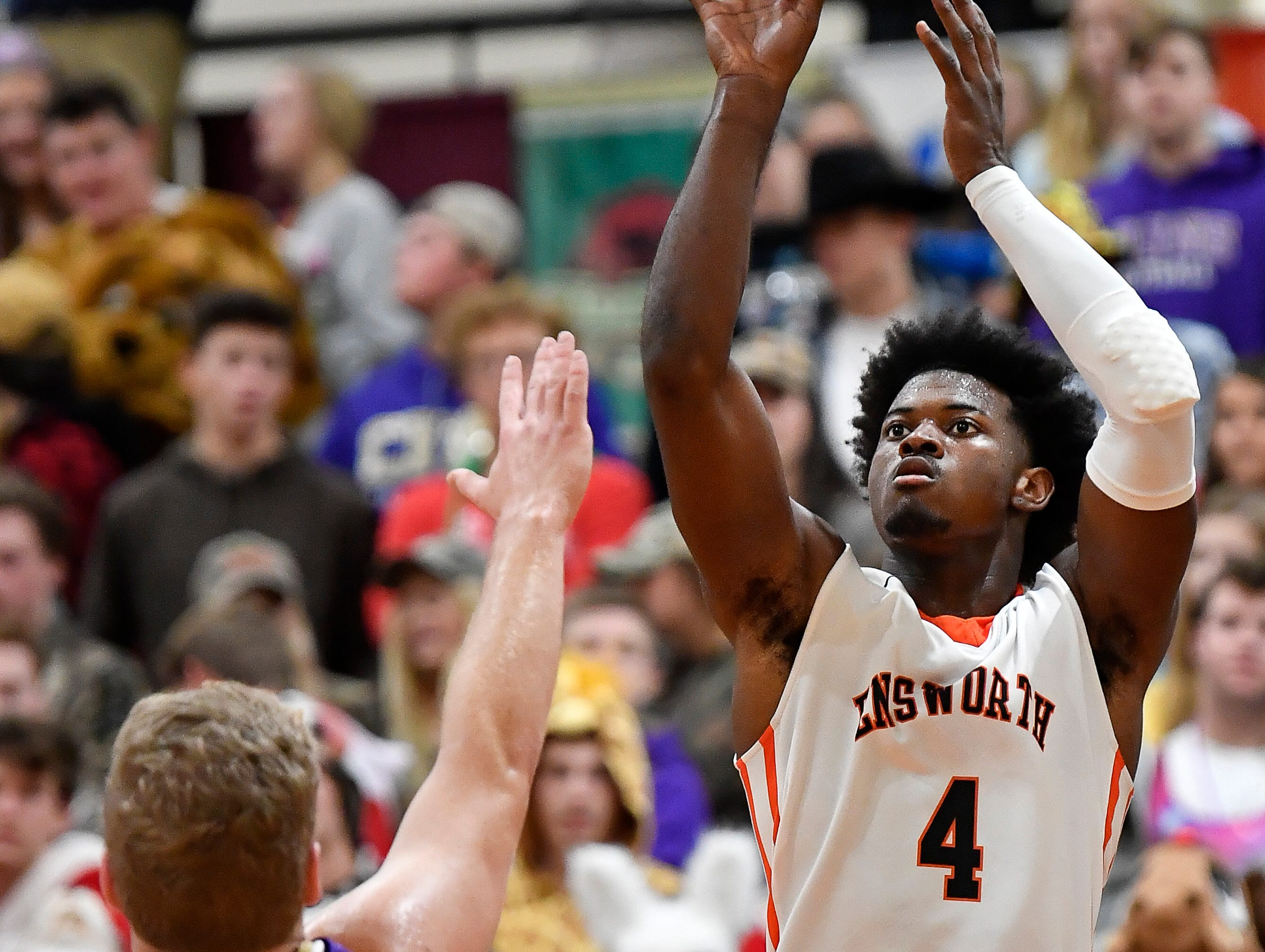 Ensworth forward Keshawn Lawrence (4) shoots over CPA's Dean Cooper (11) during their game at Ensworth High School Tuesday, Dec. 11, 2018, in Nashville, Tenn.