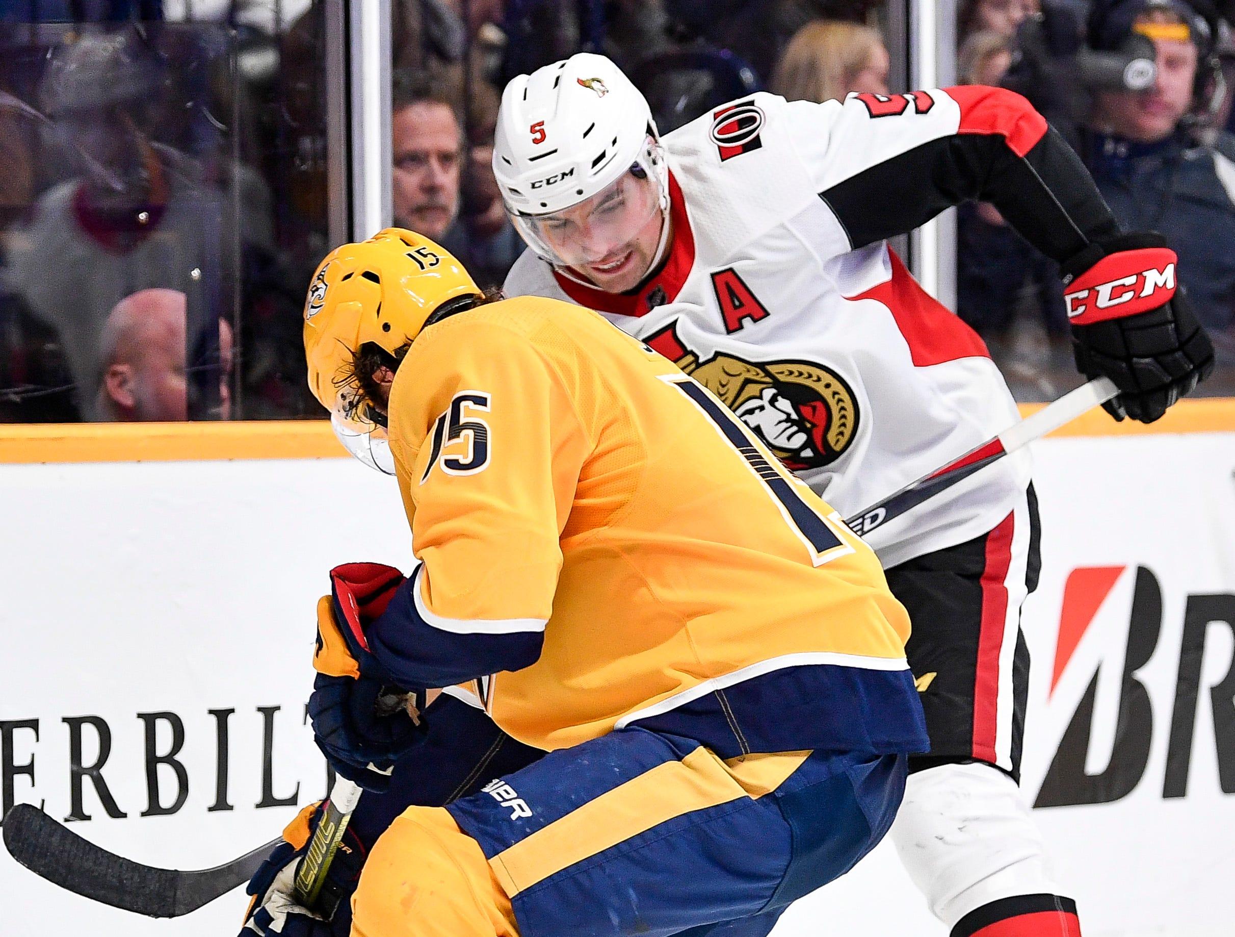 Ottawa Senators defenseman Cody Ceci (5) passes past Nashville Predators right wing Craig Smith (15) during the third period at Bridgestone Arena in Nashville, Tenn., Tuesday, Dec. 11, 2018.