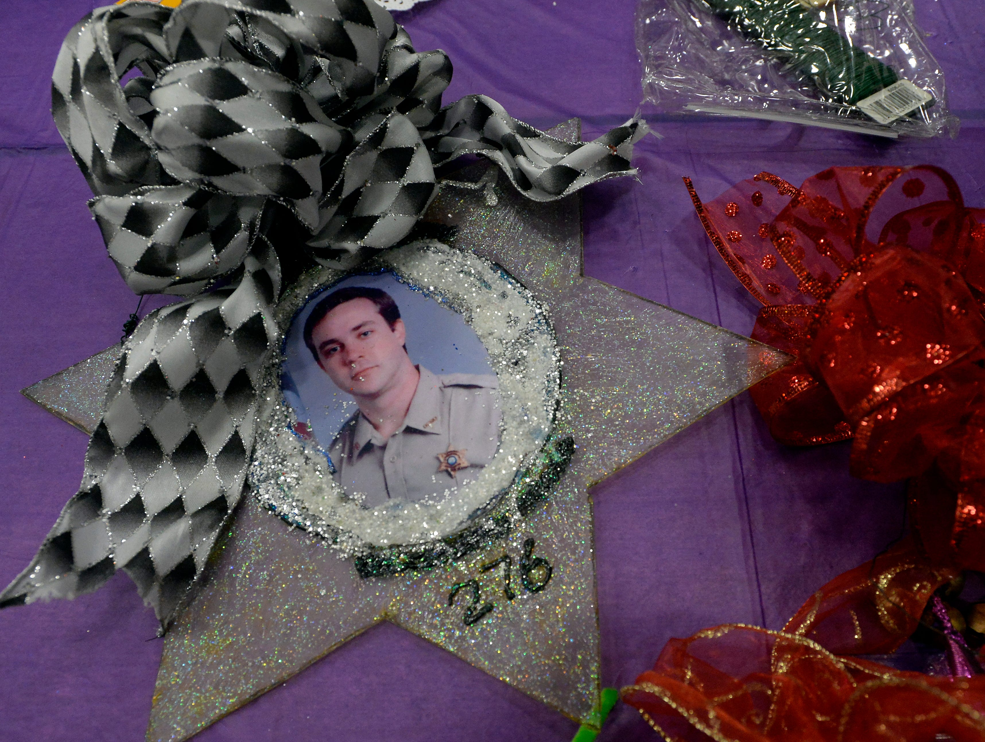 A memorial Christmas ornament of Chris Davis, who was killed in 2005, was made as part of a community outreach program at the Metro Police Department's North Precinct on Tuesday, Dec. 11, 2018, in Nashville, Tenn.