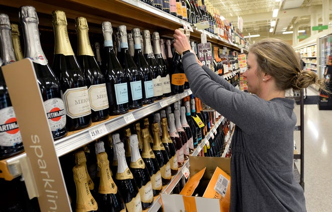 Customer service manager Amy Kirkus stocks wine bottles at a Publix grocery store Dec. 12, 2018, in Nashville. Beginning Jan. 6, grocery stores will start selling wine to customers on Sundays.
