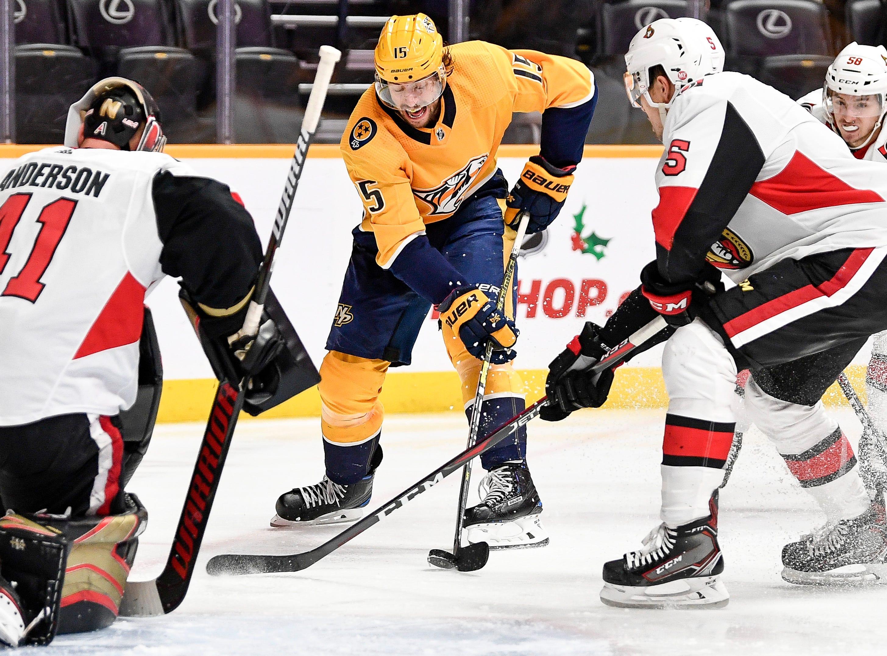 Nashville Predators right wing Craig Smith (15) moves in to score a goal against Ottawa Senators goaltender Craig Anderson (41) during the third period at Bridgestone Arena in Nashville, Tenn., Tuesday, Dec. 11, 2018.
