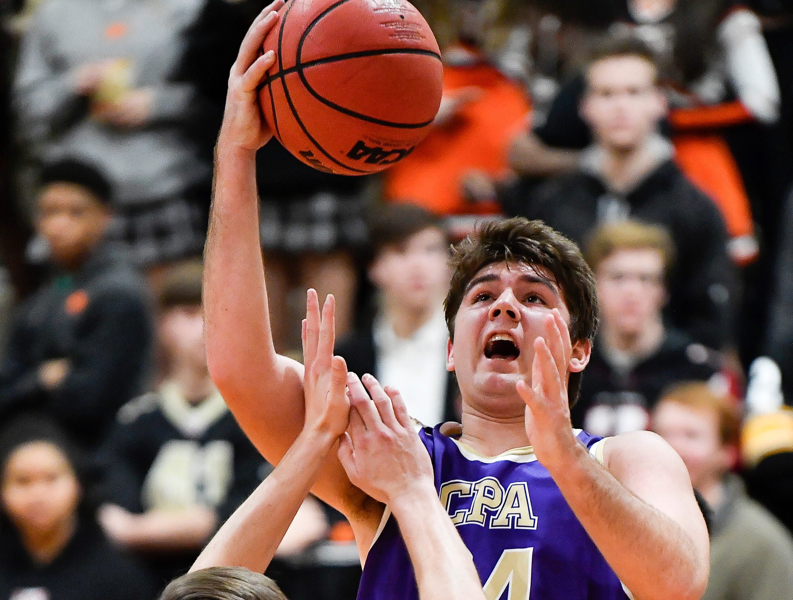 CPA's Mike McCormick shoots over Ensworth guard Ed Eubanks (12) during their game at Ensworth High School Tuesday, Dec. 11, 2018, in Nashville, Tenn.