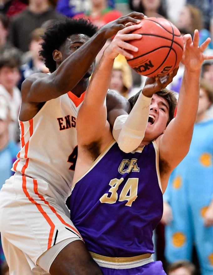 Ensworth forward Keyshawn Lawrence (4) battles for the ball with CPA's Brice McCormick (34) during their game at Ensworth High School Tuesday, Dec. 11, 2018, in Nashville, Tenn.