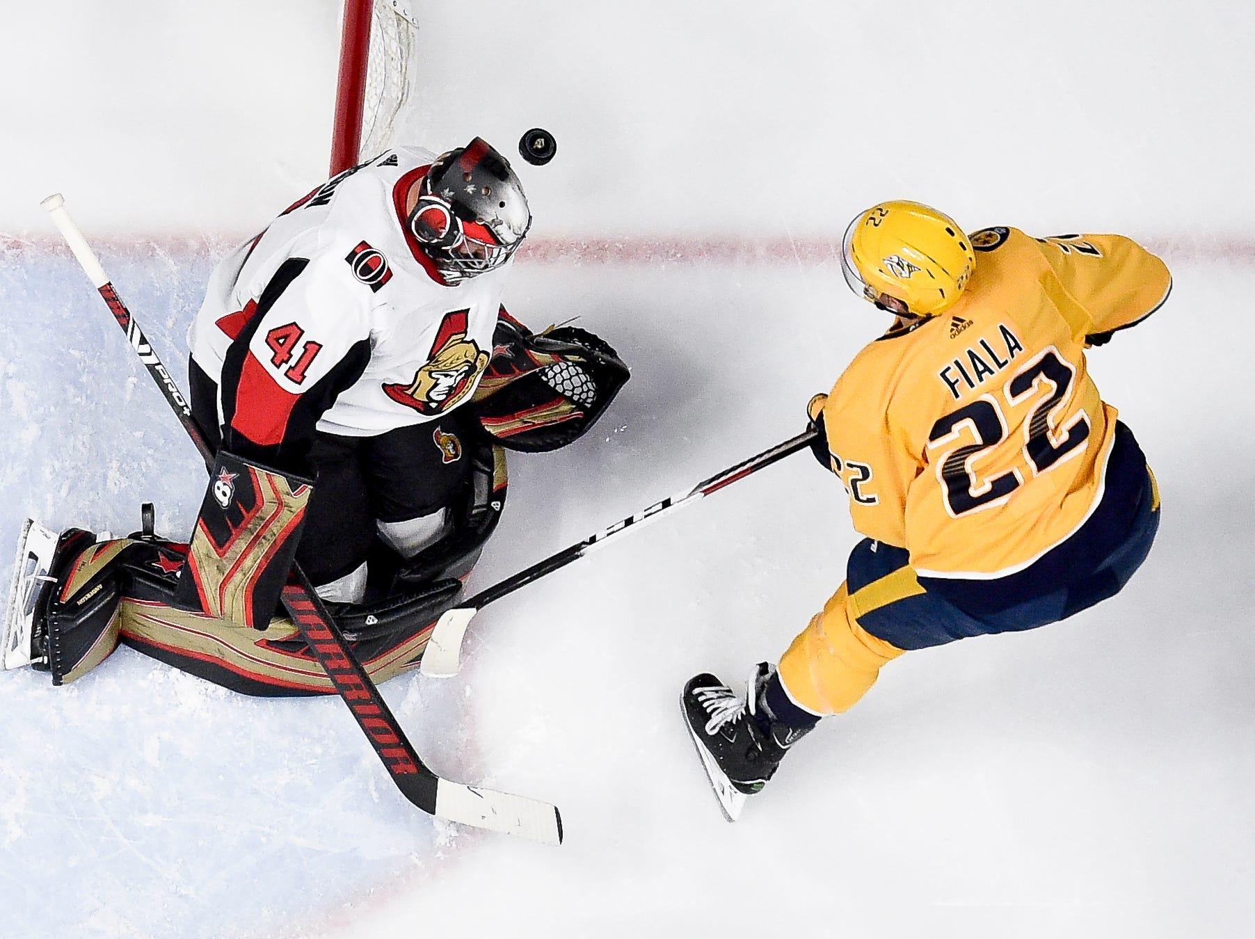 Nashville Predators left wing Kevin Fiala (22) battles Ottawa Senators goaltender Craig Anderson (41) during the second period at Bridgestone Arena in Nashville, Tenn., Tuesday, Dec. 11, 2018.