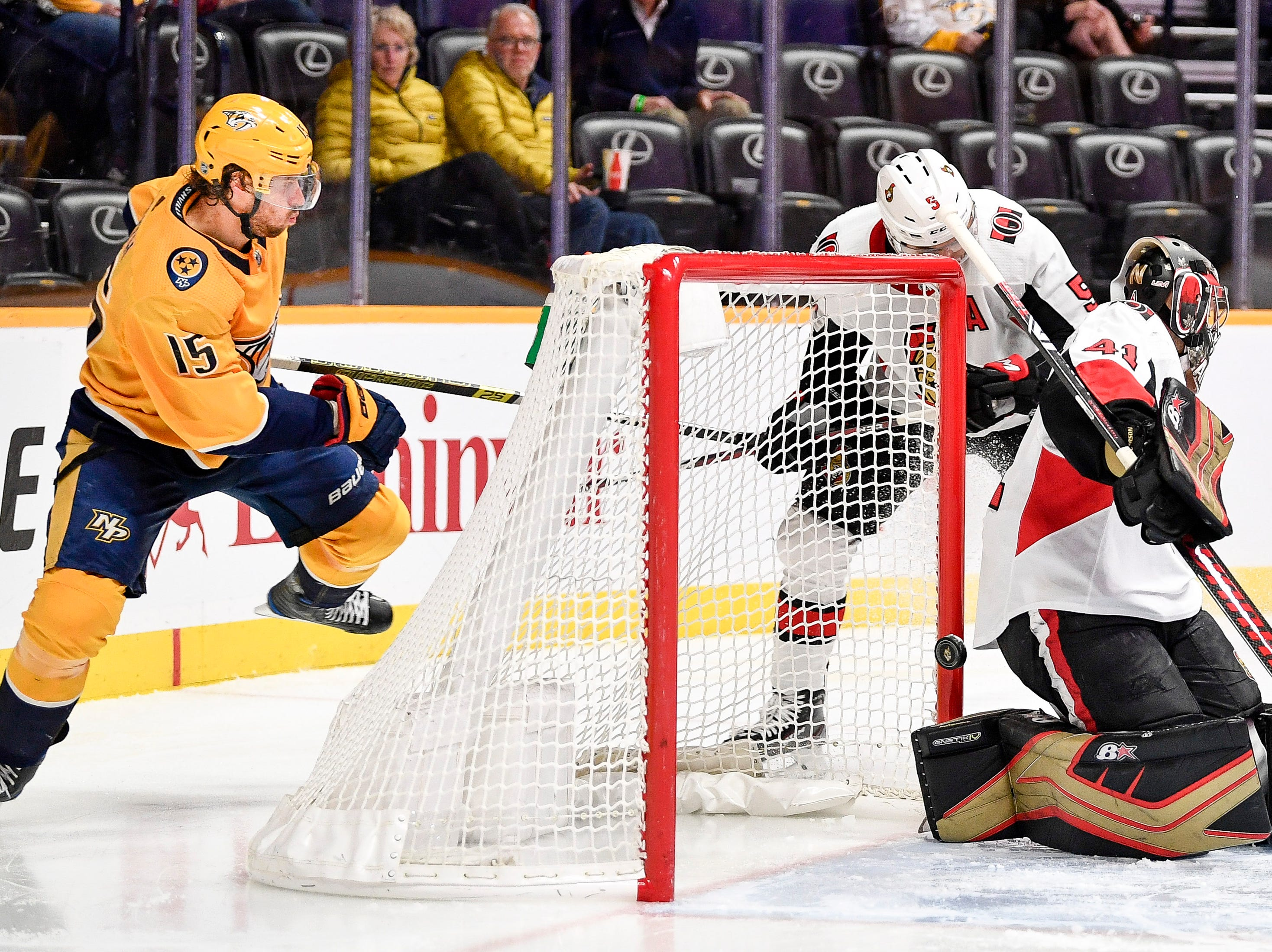 Nashville Predators right wing Craig Smith (15) scores against Ottawa Senators goaltender Craig Anderson (41) during the third period at Bridgestone Arena in Nashville, Tenn., Tuesday, Dec. 11, 2018.